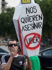 In this June 11, 2014 file photo, a demonstrator carries