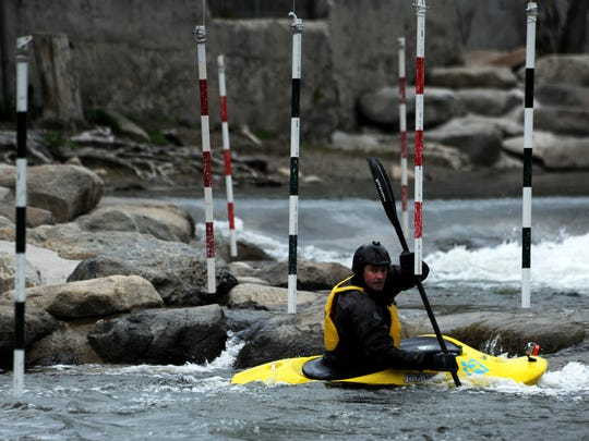 Noah Fraser runs the slalom course at the Truckee River Whitewater Park in downtown Reno on April 25, 2016. Fraser is in charge of the kayaking events at the upcoming Reno River Festival.