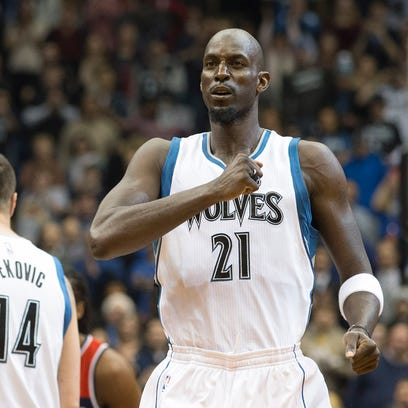Kevin Garnett pounds his chest before a game against the Washington Wizards at Target Center.