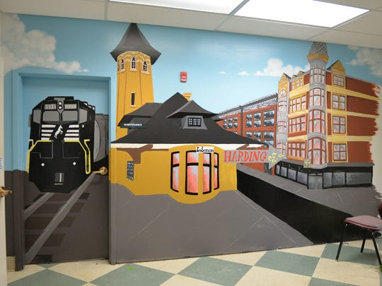 More than 100 volunteers from Wells Fargo spent Saturday morning, November 4, 2017, upgrading Harding  Elementary School. This mural, located just outside the cafeteria, depicts a scene from the City of Lebanon 100 years ago. The mural includes Harding Elementary School which will celebrate it's 100th year in 2018.