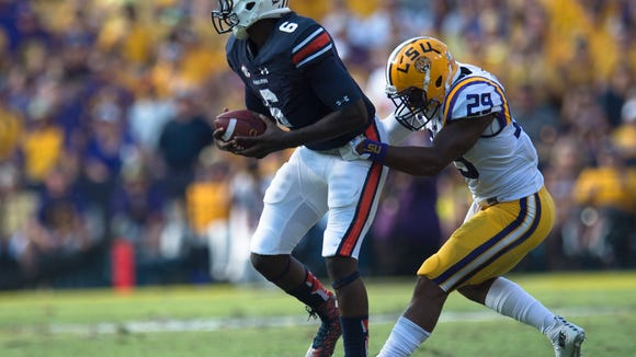 Auburn Tigers quarterback Jeremy Johnson (6) breaks a tackle attempt by Louisiana State safety Rickey Jefferson during the NCAA football game between LSU Tigers and Auburn on Saturday, Sept. 19, 2015, at Tiger Stadium in Baton Rouge, La. LSU Tigers defeated Auburn Tigers 45-21.