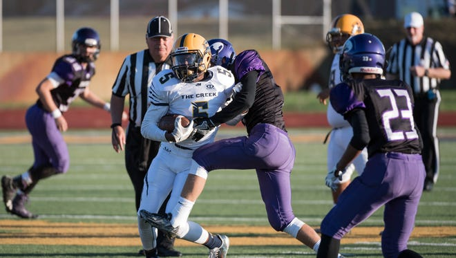 Battle Creek Central's Ke'Ondre Glass (5) is one of the top receivers in the city in high school football.