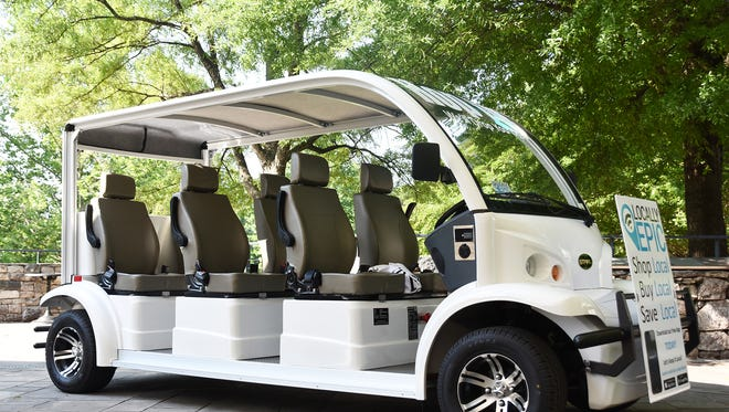 A low-speed electric vehicle operated by Locally Epic will start the Hop In service which will offer passengers a ride from one end of downtown to another.
