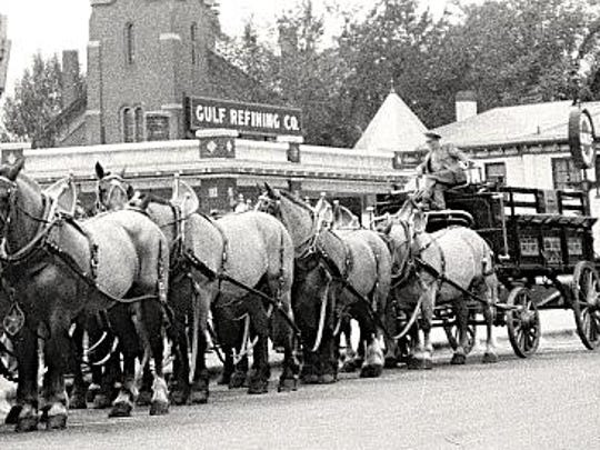 The famous Genesee 12 Horse Team from Genesee Brewing Company of Rochester, N.Y., in front of Henry's Diner in Burlington, before 1935. Henry Couture opened the diner in 1925 making it the oldest restaurant in Burlington still under the original name. Notice the truck (behind wagon) belonging to Champlain Valley Fruit Co., one of the largest companies in the state.