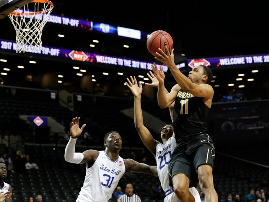 Vanderbilt's Jeff Roberson (11) drives past Seton Hall's
