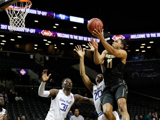 Vanderbilt's Jeff Roberson (11) drives past Seton Hall's Desi Rodriguez (20) and Angel Delgado (31) during the second half of the consolation round of the NIT Season Tip-Off tournament Saturday, Nov. 25, 2017, in New York.