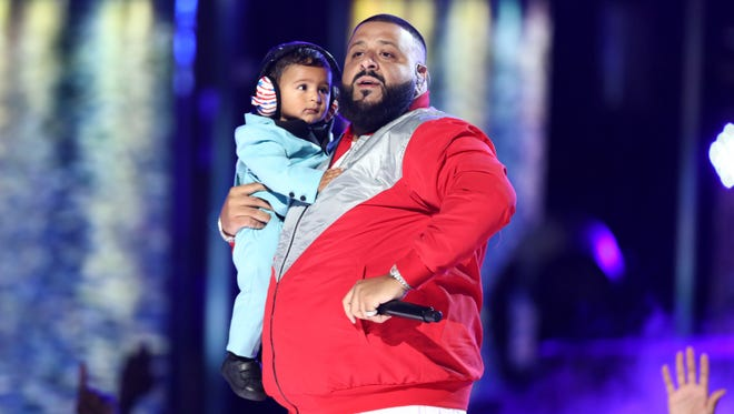 """DJ Khaled performs """"I'm The One"""" while holding his son Asahd at the BET Awards at the Microsoft Theater on Sunday, June 25, 2017, in Los Angeles. (Photo by Matt Sayles/Invision/AP)"""