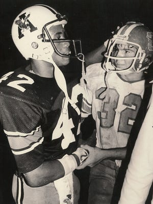 Abilene High's Vince Ford, left, offers congratulations to Cooper's Greg Hadley after the 1978 crosstown football game.