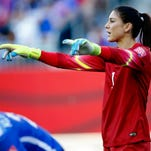United States goalkeeper Hope Solo (1) directs the team on a Sweden free kick during the first half in the women's World Cup at Winnipeg Stadium on June 12, 2015.