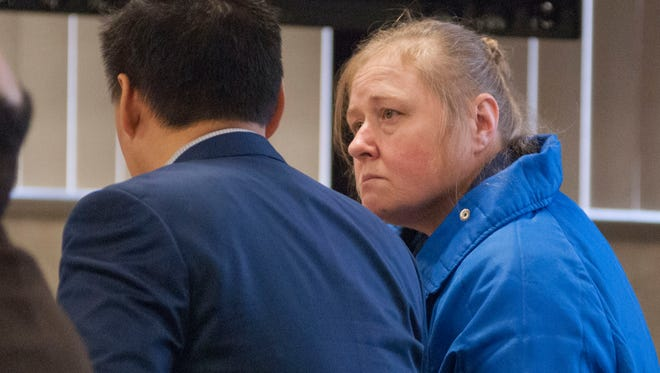Judy Higley-Zuehlke speaks with an investigator during an evidentiary hearing Wednesday, Feb. 10, 2016, in Circuit Judge Michael West's courtroom. Higley-Zuehlke was convicted in 2014 of second-degree murder in the death of her former boyfriend, John Allen.