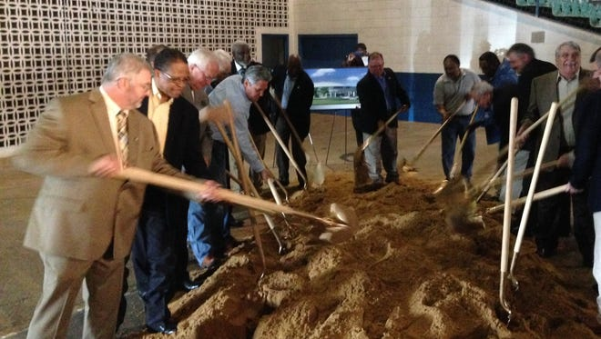 Rapides Parish police jurors and others take part in a ceremonial dirt-shoveling event Monday to launch the Rapides Parish Coliseum renovation project. Because of rainy weather, the ground-breaking ceremony was held inside the Coliseum, and dirt was brought in for the shoveling ritual.