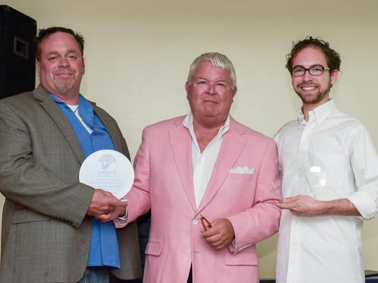 Jim Flynn, (center), Founder and Editor of Shorefoodie.com presents Taste Awards to both Douglas Walsh, (left), Owner of Jersey Shore BBQ, Belmar, and Adam Brousell General Manager of Taka, Asbury Park. The two restaurants tied for Outstanding Restaurant Speciality.