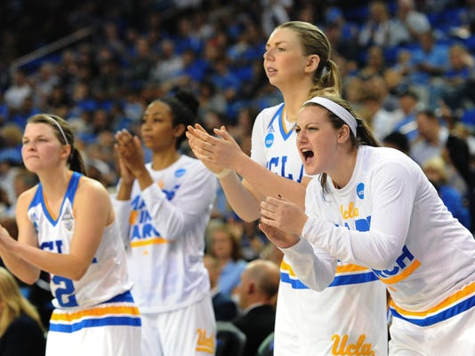 The UCLA bench cheers their team during a first-round women's college basketball game against Hawaii in the NCAA Tournament in Los Angeles, Saturday, March 19, 2016. UCLA won 66-50. (AP Photo/Michael Owen Baker)
