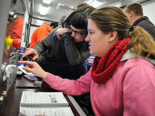 Hannah Connors (left), Asbury Park, and Sarah Dwight, Red Bank, work on a practice controller in a metal fabrication training session held at Brookdale Community College, Middletown.