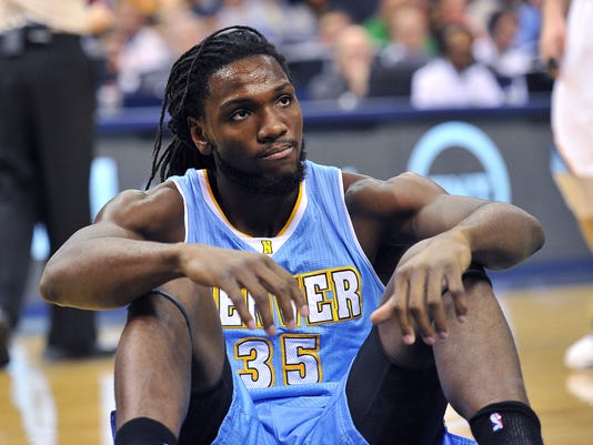Denver Nuggets forward Kenneth Faried sits on the court after falling during the first half of an NBA basketball game against the Memphis Grizzlies on Thursday, Jan. 29, 2015, in Memphis, Tenn. (AP Photo/Brandon Dill)