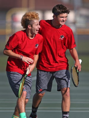 North Central's No. 1 doubles team JJ Kroot (left) and Jon Tuerk celebrate a point  at the boys tennis team state finals Oct. 17, 2015.