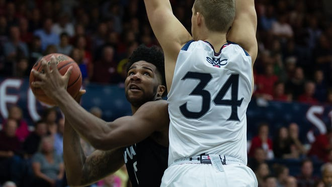 Wolf Pack forward Elijah Foster looks to the basket against St. Mary's center Jock Landale during their game Friday.