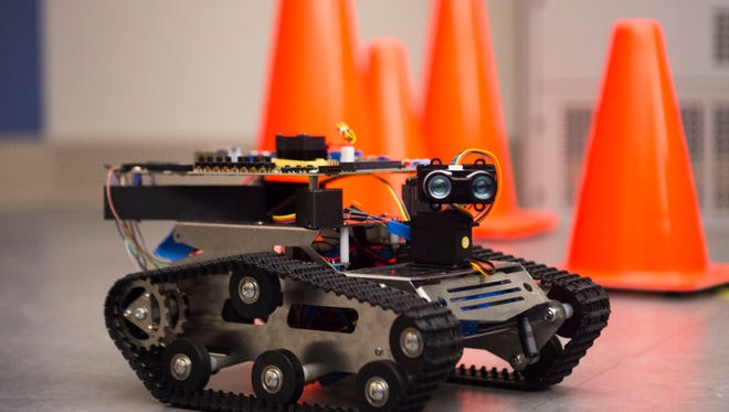NeoN, an autonomous robot which can avoid objects in it's environment using a brain-inspired computing model, moves around a lab in the Min H. Kao building at University of Tennessee Friday, Jan. 19, 2017.