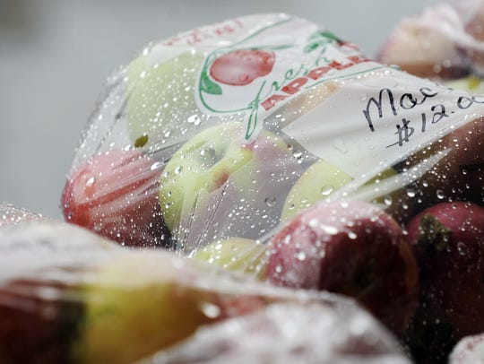 """Raindrops collect on a bag of """"Macs"""" at Apple Fest"""