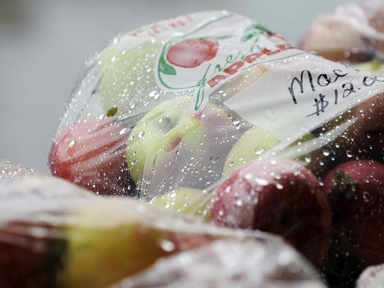 """Raindrops collect on a bag of """"Macs"""" at Apple Fest in Two Rivers in 2012."""