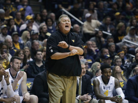 West Virginia head coach Bob Huggins calls a play during the second half of an NCAA college basketball game against Baylor Tuesday, Jan. 9, 2018, in Morgantown, W.Va. (AP Photo/Raymond Thompson)