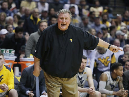 FILE - In this Monday, Jan. 15, 2018, file photo, West Virginia head coach Bob Huggins screams directions to his players during the first half of an NCAA college basketball game against Kansas in Morgantown, W.Va. Before their teams meet again on the basketball court, close pals Huggins and John Calipari of Kentucky will renew their bond at a charity event on Friday, Jan. 26, 2018. (AP Photo/Raymond Thompson, File)
