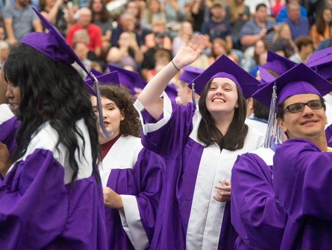 Lakeview High School graduates wave to family and friends