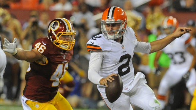 Washington Redskins inside linebacker Will Compton (46) pursues Cleveland Browns quarterback Johnny Manziel (2) during the second half of an NFL preseason football game Monday, Aug. 18, 2014, in Landover, Md.