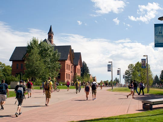 Students make their way through campus at Montana State University in Bozeman, Aug. 29, 2011.