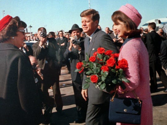 President John F. Kennedy and wife Jacqueline arrive in Dallas Nov. 22, 1963. In less than an hour, at the end of his city motorcade route, he will be fatally shot.