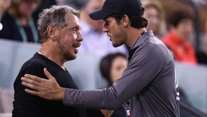 BNP Paribas Open owner Larry Ellison, left, talks with Tommy Haas at Indian Wells Tennis Garden on March 10, 2016.