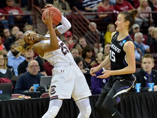 South Carolina's Tiffany Mitchel, left, is fouled by Kansas State's Megan Deines during the first half of a second-round women's college basketball game in the NCAA Tournament on Sunday, March 20, 2016, in Columbia, S.C.  (AP Photo/Richard Shiro)