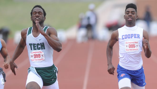 Cooper's Terreon Paige, right, finishes second in the 100 to Fort Worth Trimble Tech's Keishawn Everly at the Region I-5A meet Saturday, April 29, 2017 at Lowrey Field in Lubbock.