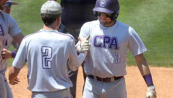 CPA's Philip Clarke (3) is congratulated by Johnny Dodd after scoring against CAK during the Class AA Baseball State Championship game during Spring Fling on Friday, May 26, 2017.