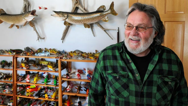 Dennis Bertram, Belgrade, talks Feb. 24 about the variety of sizes and colors of fish decoys he makes.