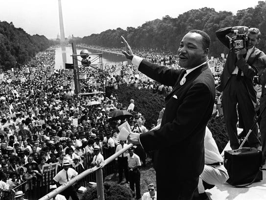 Martin Luther King Jr. waves to supporters Aug. 28,