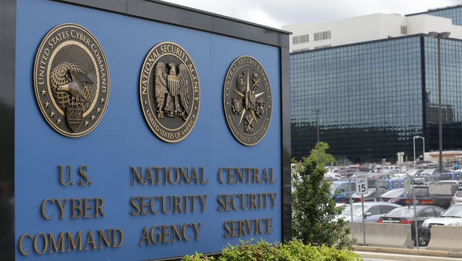 In this June 6, 2013 file photo, the sign outside the National Security Administration (NSA) campus in Fort Meade, Md. A contractor for the National Security Agency has been arrested on charges that he illegally removed highly classified information and stored the material in his house and car, federal prosecutors announced.