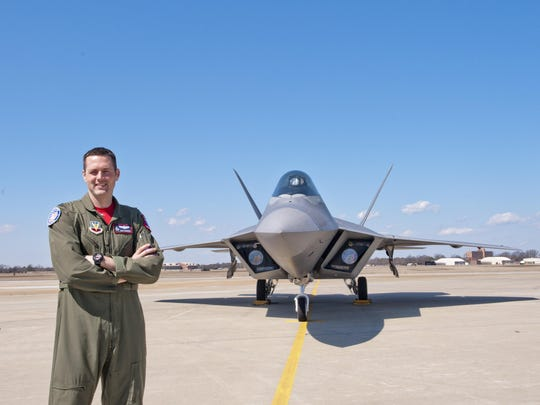 """USAF Maj. John """"Taboo"""" Cummings stands in front of his F-22 Raptor fighter during a recent break. Cummings and the Raptor will be flying at this year's California International Airshow Salinas, Sept. 26-27 at Salinas Municipal Airport."""
