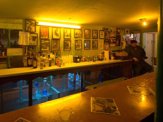 Tony Gradney sits behind the bar at Slim's Y-Ki-Ki during the 2013 Tribute to Roy Carrier.