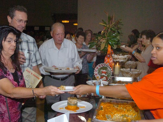 This Advertiser file photo shows a line forming to sample food being served at the annual Soirée Royale event.