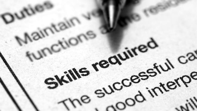 Pen hovering over skills required section of a job listing