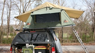 Roof top tents weigh about 120 pounds. The adjustable aluminum ladder provides a stable anchor when the tent is set up.