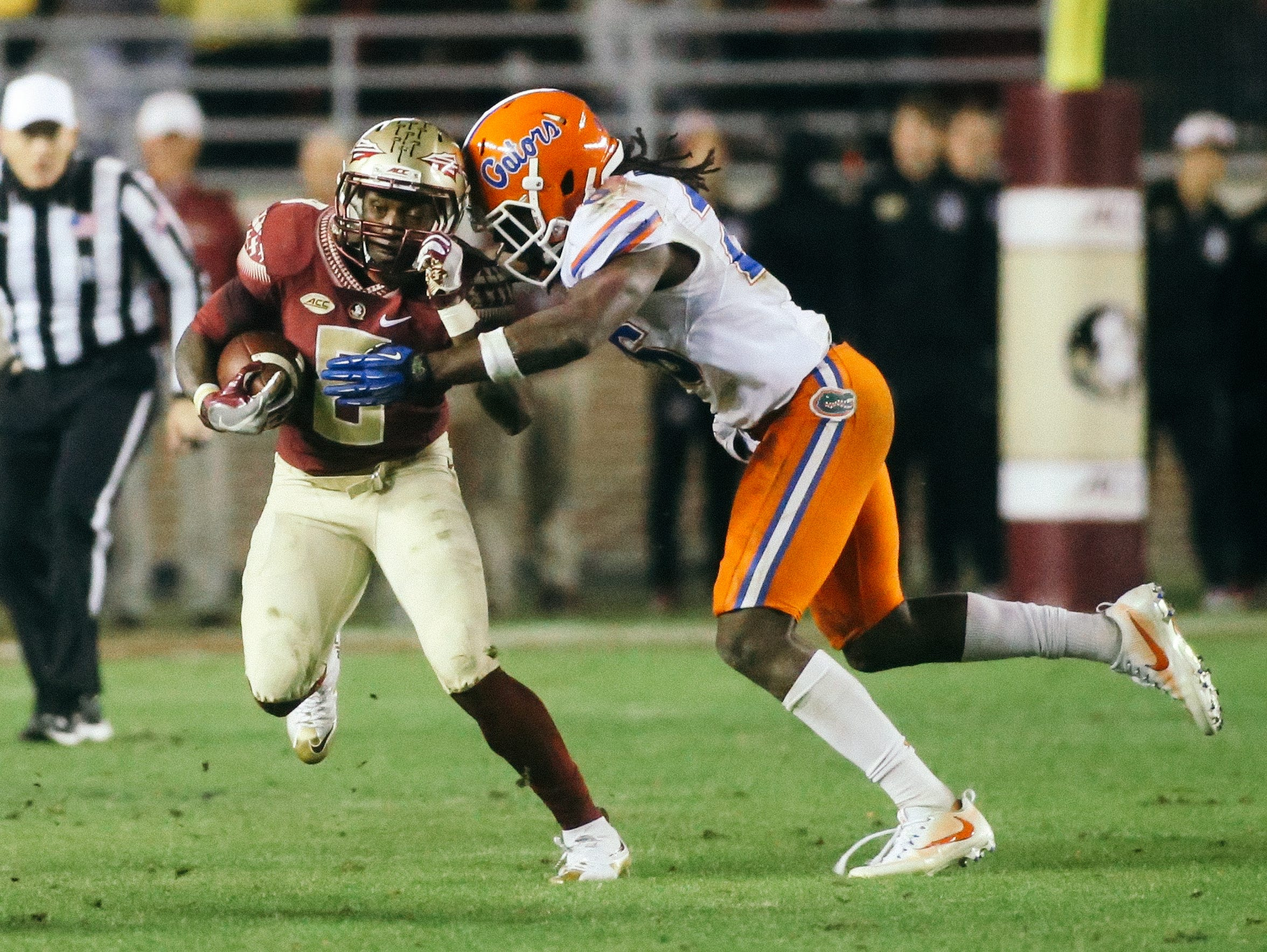 Kermit Whitfield (8) is tackled by Marcell Harris (26)