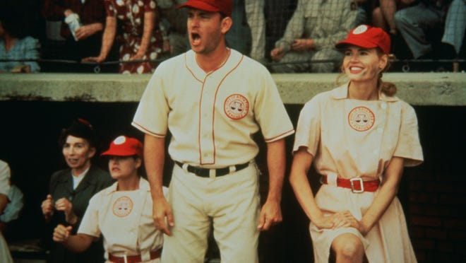 """Tom Hanks and Geena Davis in a scene from """"A League of Their Own."""" Hanks, who played Rockford Peaches manager Jimmy Dugan in the 1992 movie, was an honorary co-chair of a September celebration in Rockford honoring director Penny Marshall. The film will be shown Saturday, Aug. 15, 2020, outside in the Don Carter Lanes parking lot as part of Rockford Day celebrations."""