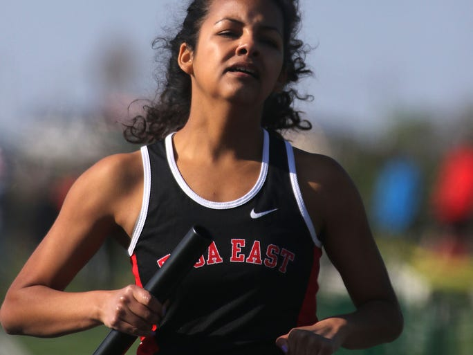 Wauwatosa East's Amara Green crosses the finish line at the end of the Girls 4X800 Meter Relay Event of the 36th Annual Dan Benson Invitational Track and Field Meet held at Wauwatosa West High School Friday, April 29, 2016, in Wauwatosa, Wisconsin. Wauwatosa East won the event.