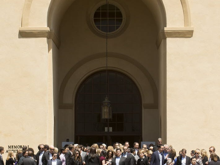 Friends of Dave Goldberg gather after his memorial service Tuesday at Stanford University's Memorial Auditorium.