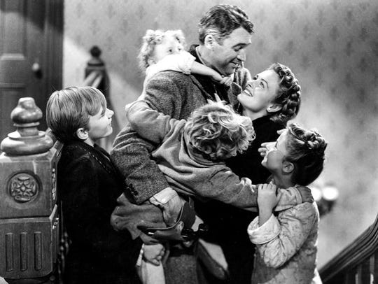 "Jimmy Stewart, center, starred in the 1946 classic, ""It's A Wonderful Life."" with actress, Donna Reed, right."