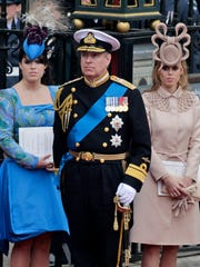 Prince Andrew Duke of York flanked by his daughters,