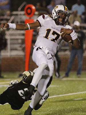 Pearl River quarterback Markevion Quinn skips away from a would-be tackler on the way to one of his three rushing touchdowns against East Central Thursday night at Decatur.