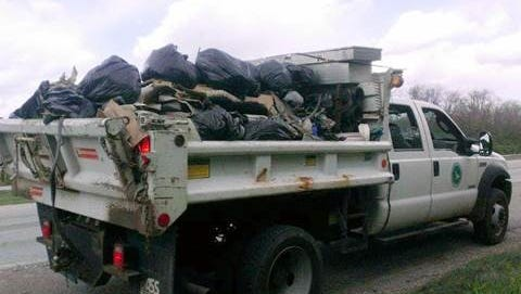 Crew collect trash from Ohio highways Tuesday.